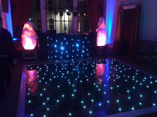 Wedding entertainer london wedding disco djsmobile disco london black led star lit dance floor with black dj booth solutioingenieria Images